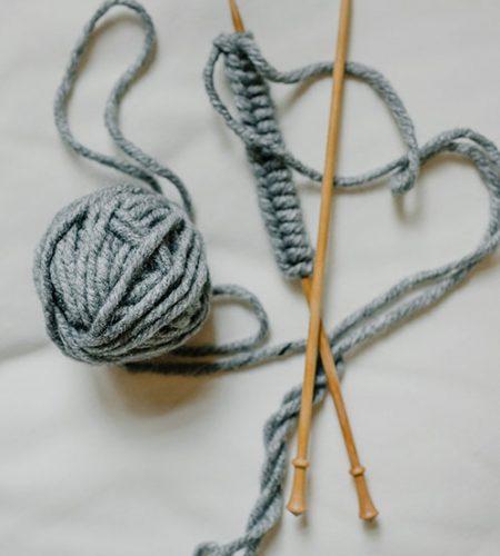 grey-knitting-needles-498X650
